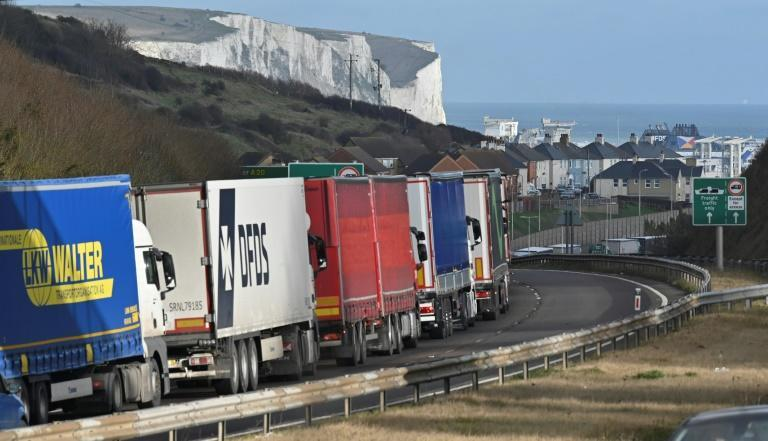 Freight lorries queue on the main route into the port of Dover on the south coast of England on December 10, 2020