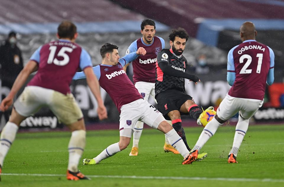 Liverpool's Mohamed Salah scores their first goal against West Ham.