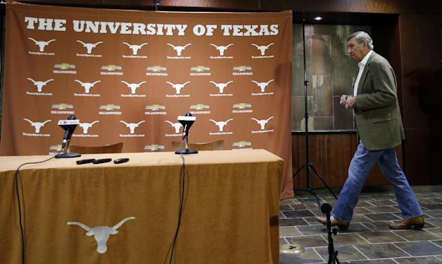 Texas athletic director DeLoss Dodds arrives for a news conference where he formally announced his retirement, Tuesday, Oct. 1, 2013, in Austin, Texas. Dodds, who has been with Texas for 32 years, will step down in August 2014. (AP Photo/Eric Gay)