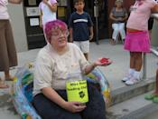 """<div class=""""caption-credit"""">Photo by: Queens Library</div>2006 Challenge: Read 1,000 books <br> Final Results: 4,654 books <br> """"As a joke, I used to say that I would sit in a tub of jello to get kids to read, so I thought, why not really do it?"""" says Scatena. """"I filled a kiddie pool with jello that I made from industrial gelatin and let kids dye my hair purple."""" After the event, Scatena won an award from the James Patterson Foundation for her efforts and posed as """"Ms. June"""" in a calender honoring important people in the community. <br>"""