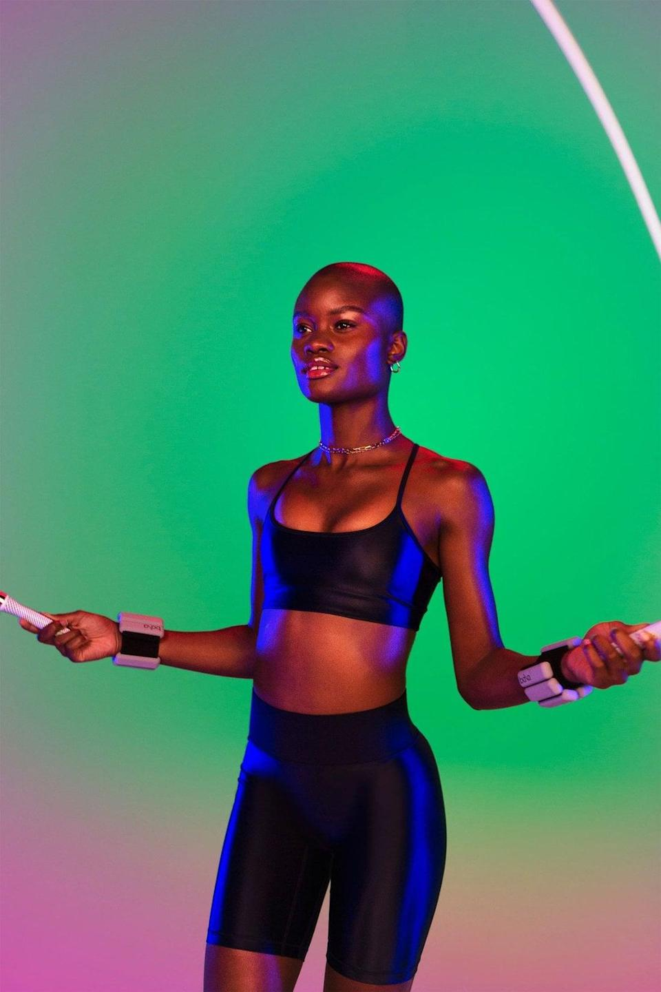 <p>This shiny <span>All Access The Nice Middrift Kit</span> ($140) comes with a bra and bike shorts. We love it.</p>