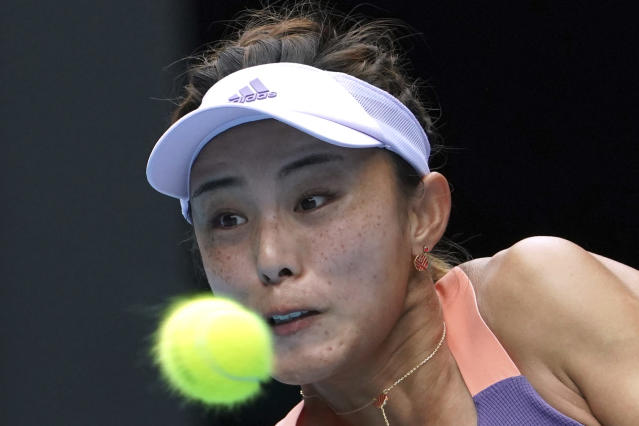 China's Wang Qiang returns a shot to Serena Williams of the U.S. in their third round singles match at the Australian Open tennis championship in Melbourne, Australia, Friday, Jan. 24, 2020. (AP Photo///)