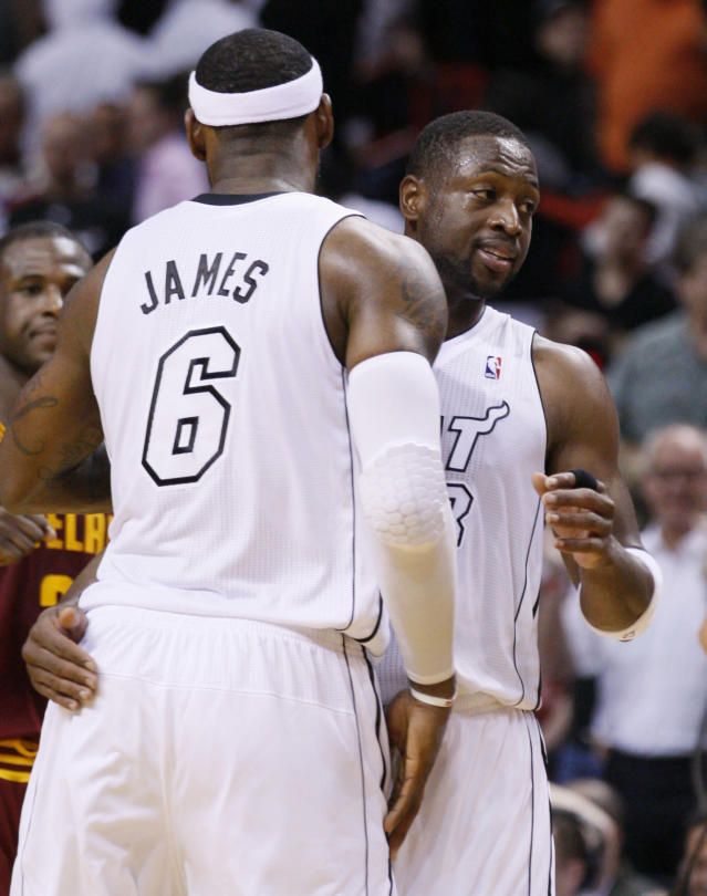 <p> Miami Heat forward LeBron James (6) and guard Dwyane Wade celebrate after they defeated the Cleveland Cavaliers 110-108 in an NBA basketball game on Saturday, Nov. 24, 2012, in Miami. James finished with 30 points for the Heat, who remained perfect at home despite leading for only 2 minutes, 29 seconds, and Wade added 18 points. (AP Photo/Wilfredo Lee) </p>