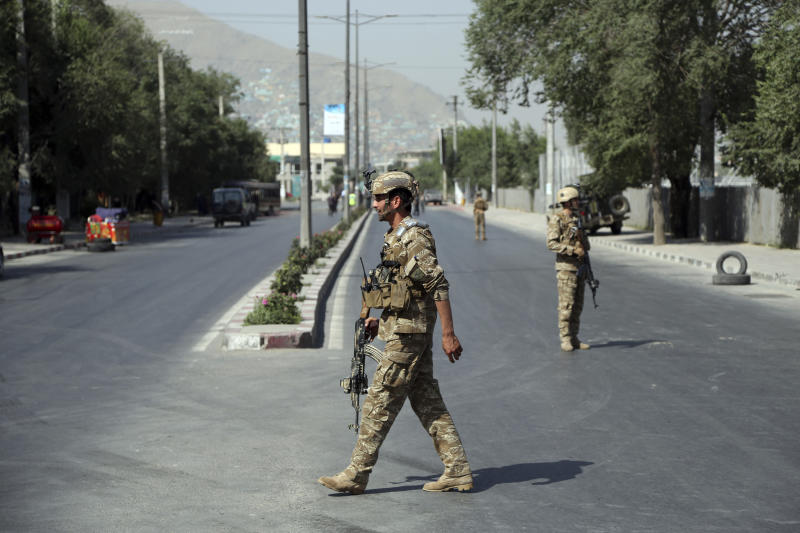 Afghan forces secure the area after a suicide attack in Kabul, Afghanistan, Thursday, July 25, 2019. Three bombings struck the Afghan capital on Thursday, killing at least eight people, including five women and one child, officials said Thursday. (AP Photo/Rahmat Gul)