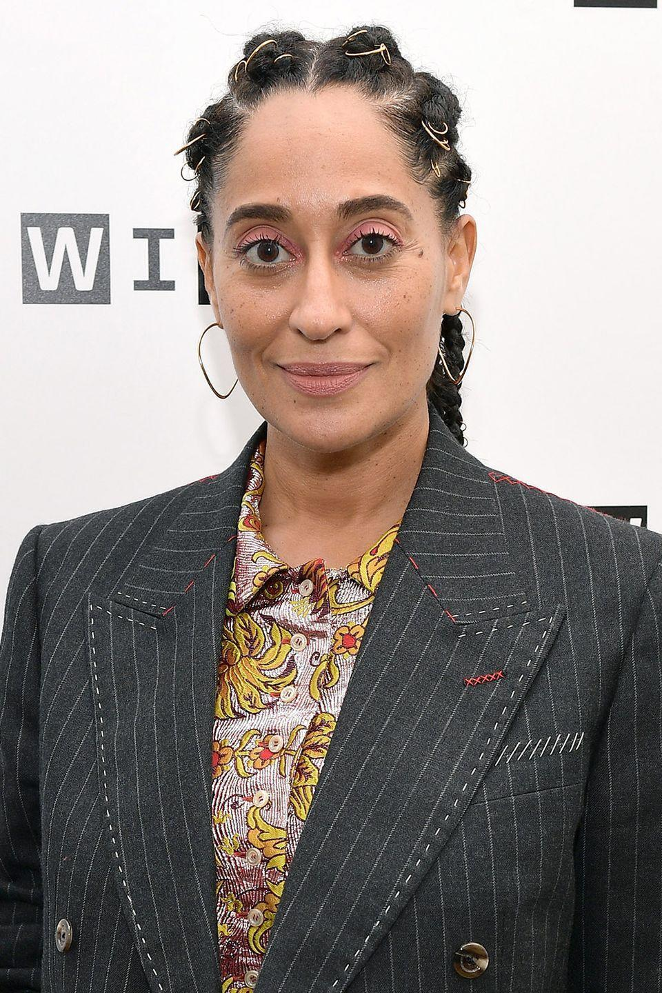 <p>Like jewelry for your hair, don't be afraid to add golden string to your braids like seen here on Tracee Ellis Ross. </p>
