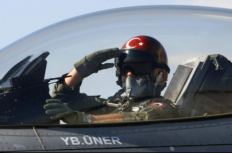 """FILE - In this April 29, 2010 file photo, a Turkish pilot salutes before take-off at an air base in Konya, Turkey. Turkish President Abdullah Gul said Saturday June 23, 2012, his country would take """"necessary"""" action against Syria for the downing of a Turkish military jet, but suggested that the aircraft may have unintentionally violated the Syrian airspace. The plane went down in the Mediterranean Sea about 8 miles (13 kilometers) away from the Syrian town of Latakia, Turkey said. (AP Photo/File)"""