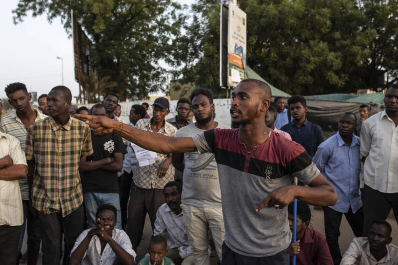 A protesters gives a speech at the sit-in inside the Armed Forces Square, in Khartoum, Sudan, Wednesday, April 17, 2019. A Sudanese official and a former minister said the military has transferred ousted President Omar al-Bashir to the city's Kopar Prison in Khartoum. The move came after organizers of the street protests demanded the military move al-Bashir to an official prison. (AP Photos/Salih Basheer)