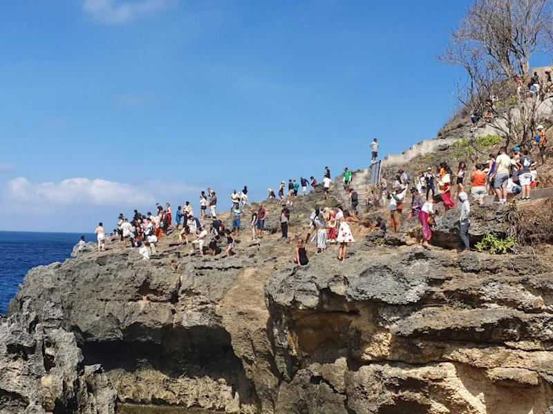 Crowds on rock in Nusa Penida