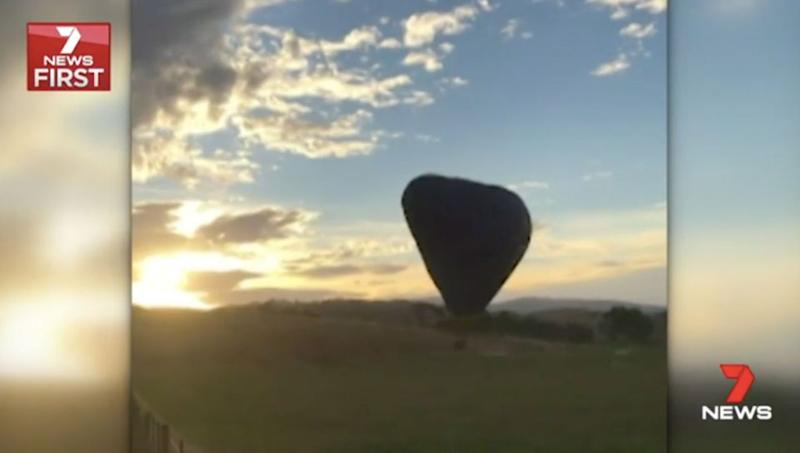 The hot air balloon crashes to the ground. Source: 7 News