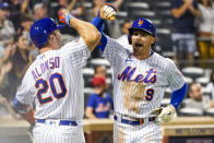 New York Mets' Brandon Nimmo (9) celebrates with Pete Alonso (20) after hitting a solo home run during the eighth inning of a baseball game against the Philadelphia Phillies, Saturday, Sept. 18, 2021, in New York. (AP Photo/Mary Altaffer)