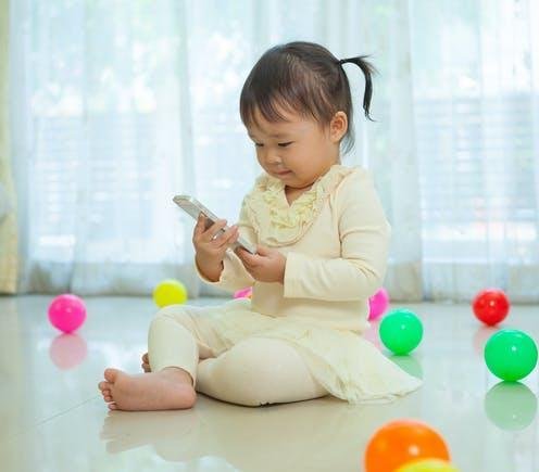 "<span class=""attribution""><a class=""link rapid-noclick-resp"" href=""https://www.shutterstock.com/image-photo/happy-little-asian-girl-using-mobile-193624790"" rel=""nofollow noopener"" target=""_blank"" data-ylk=""slk:WitthayaP/Shutterstock"">WitthayaP/Shutterstock</a></span>"