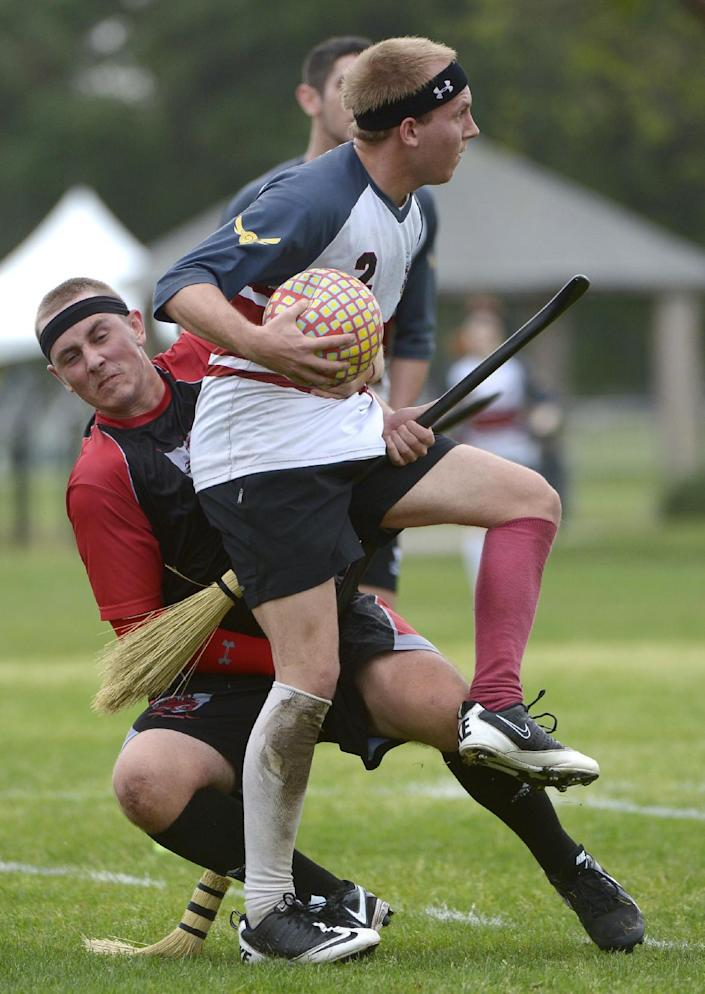 The University of Ottawa Quidditch team's Steven Kimball, front, spins away from the Silicon Valley Skrewts' Willis Miles IV during a scrimmage at the Quidditch World Cup in Kissimmee, Fla., Friday, April 12, 2013. Quidditch is a game born within the pages of Harry Potter novels, but in recent years it's become a real-life sport. The game is a co-ed, full contact sport that combines elements of rugby, dodgeball and Olympic handball. (AP Photo/Phelan M. Ebenhack)
