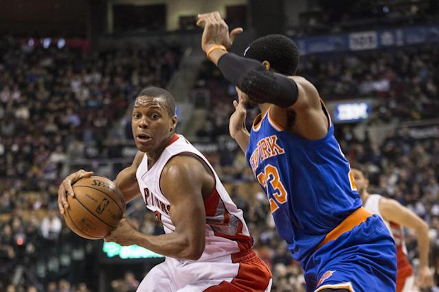 Toronto Raptors' Kyle Lowry, left, drives at New York Knicks' Toure' Murry during first-half NBA basketball game action in Toronto, Saturday, Dec. 28, 2013. (AP Photo/The Canadian Press, Chris Young)