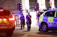 <p>Armed police outside Monument station as police are responding to three incidents in the capital. Yui Mok/PA Wire </p>