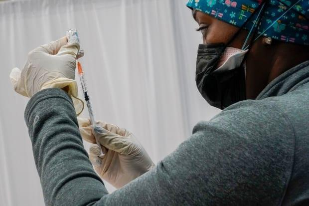 A nurse fills a syringe with the Johnson & Johnson COVID-19 vaccine at a pop-up vaccination site in New York City on April 8.  (Mary Altaffer/The Associated Press - image credit)