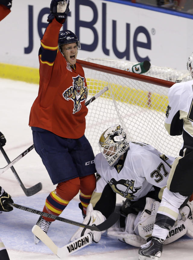 Florida Panthers' Jonathan Huberdeau (11) celebrates after scoring against Pittsburgh Penguins' goalie Jeff Zatkoff (37) in the second period of an NHL hockey game on Friday, Oct. 11, 2013, in Sunrise, Fla. (AP Photo/Alan Diaz)