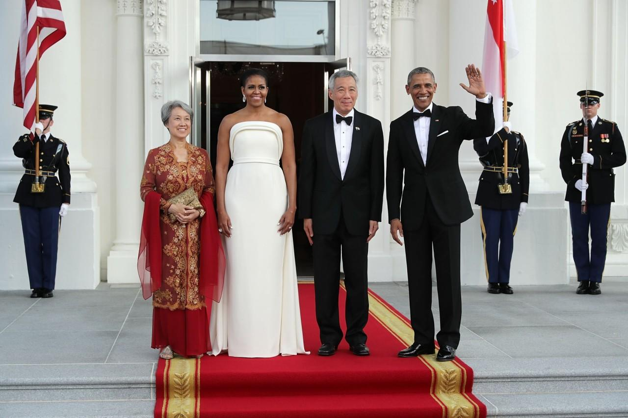 <p>For the state dinner hosting Singapore in August 2016, Michelle Obama chose a gown designed by Brandon Maxwell, Lady Gaga's stylist. Funny enough, the singer wore a strikingly similar piece (albeit with pants) to the Oscars just months before. (Photo: Getty Images) </p>