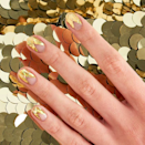 A gold foil mani feels almost as festive as a sequin mini dress when you've been wearing sweats for the majority of the year.