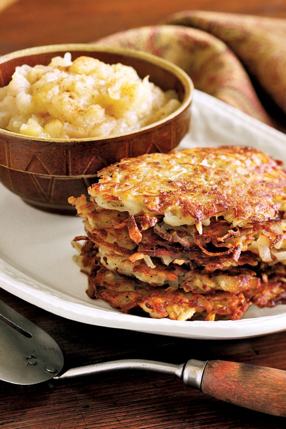 """<p>Golden fried potato pancakes receive a boost from freshly grated nutmeg.</p><p><strong><a href=""""https://www.countryliving.com/food-drinks/recipes/a855/potato-pancakes-nutmeg-42/"""" rel=""""nofollow noopener"""" target=""""_blank"""" data-ylk=""""slk:Get the recipe"""" class=""""link rapid-noclick-resp"""">Get the recipe</a>.</strong></p>"""