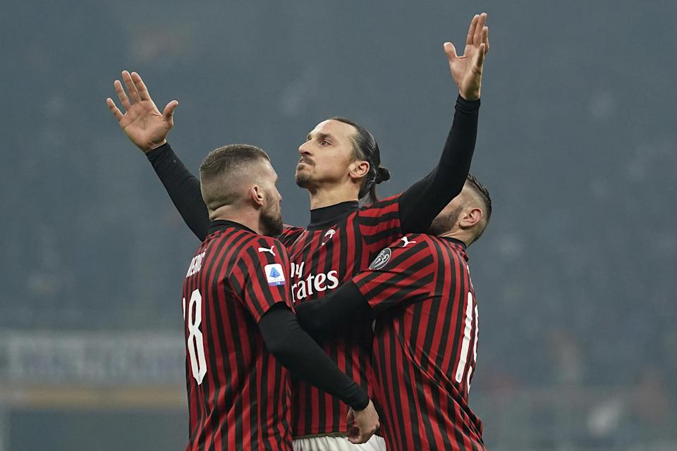 AC Milan's Zlatan Ibrahimovic, center, celebrates with teammates Ante Rebic, left, and Theo Hernandez after scoring his side's second goal during the Serie A soccer match between Inter Milan and AC Milan at the San Siro Stadium, in Milan, Italy, Sunday, Feb. 9, 2020. (Spada/Lapresse via AP)