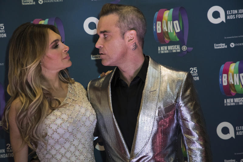Singer Robbie Williams, right, and actress Ayda Field pose for photographers upon arrival at the premiere of the musical 'The Band', in London, Tuesday, Dec. 4, 2018. (Photo by Vianney Le Caer/Invision/AP)