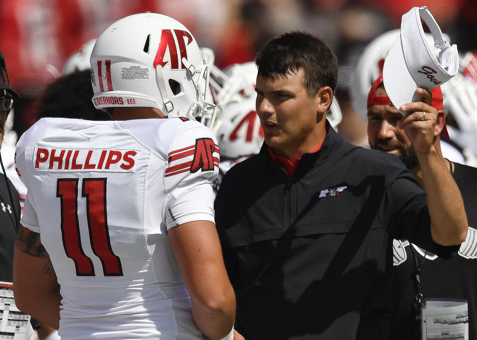 Austin Peay head coach Will Healy speaks to Austin Peay wide receiver DeAngelo Wilson (11) during the first half of an NCAA college football game, Saturday, Sept. 1, 2018, in Athens, Ga. (AP Photo/Mike Stewart)
