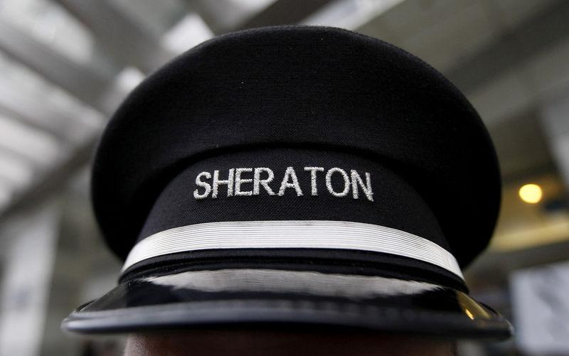 FILE PHOTO: A doorman's hat at Sheraton hotel, a brand of Starwood Hotels & Resorts Worldwide, is pictured in Warsaw in this February 24, 2012 file photo. REUTERS/Kacper Pempel/Files//File Photo