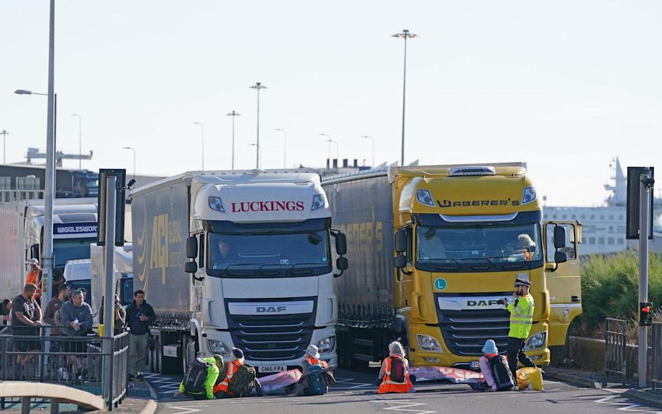 Protesters from Insulate Britain block the A20 in Kent, which provides access to the Port of Dover in Kent - Gareth Fuller/PA