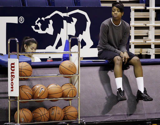 FILE - In this Nov. 7, 2012, file photo, California's Tierra Rogers, right, watches from the sidelines during an NCAA college basketball practice in Berkeley, Calif. The former California basketball player, who never played a single minute because of a rare heart condition that could have killed her, has that diploma in hand at last, four years after a frightening collapse that derailed her college career before it began. The highly touted guard stopped breathing outside the Cal training room in September 2009. While she never played for the Golden Bears, ranked No. 10 this week, Rogers attended practice whenever possible and played a part in Cal's first ever trip to the Final Four last season. (AP Photo/Ben Margot, File)