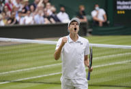 Poland's Hubert Hurkacz celebrates winning the third set against Italy's Matteo Berrettini during the men's singles semifinals match on day eleven of the Wimbledon Tennis Championships in London, Friday, July 9, 2021. (AP Photo/Kirsty Wigglesworth)