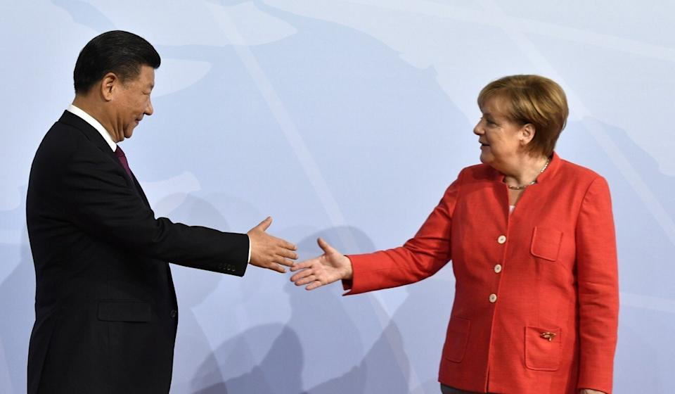 Angela Merkel, pictured with Chinese President Xi Jinping, was key driver of the deal but is stepping down later this year. Photo: AFP/Getty Images