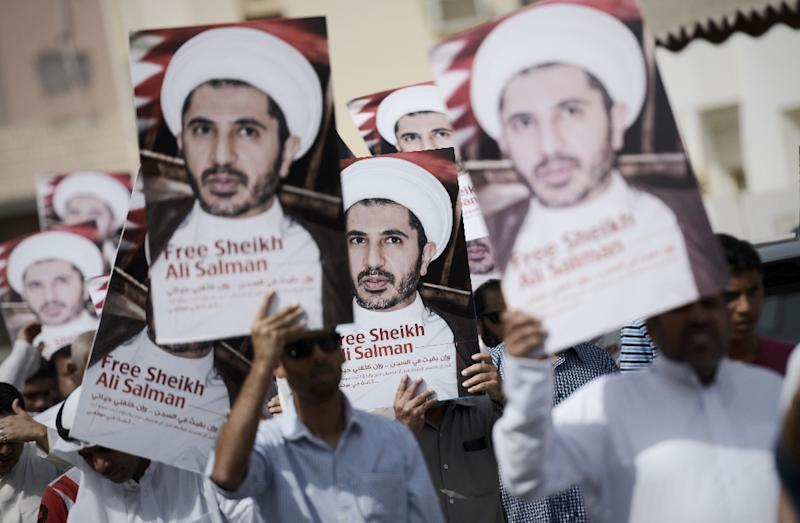 Bahraini protesters hold portraits of Sheikh Ali Salman, head of the Shiite opposition movement Al-Wefaq, during a demonstration against his arrest, in the village of Diraz on October 9, 2015