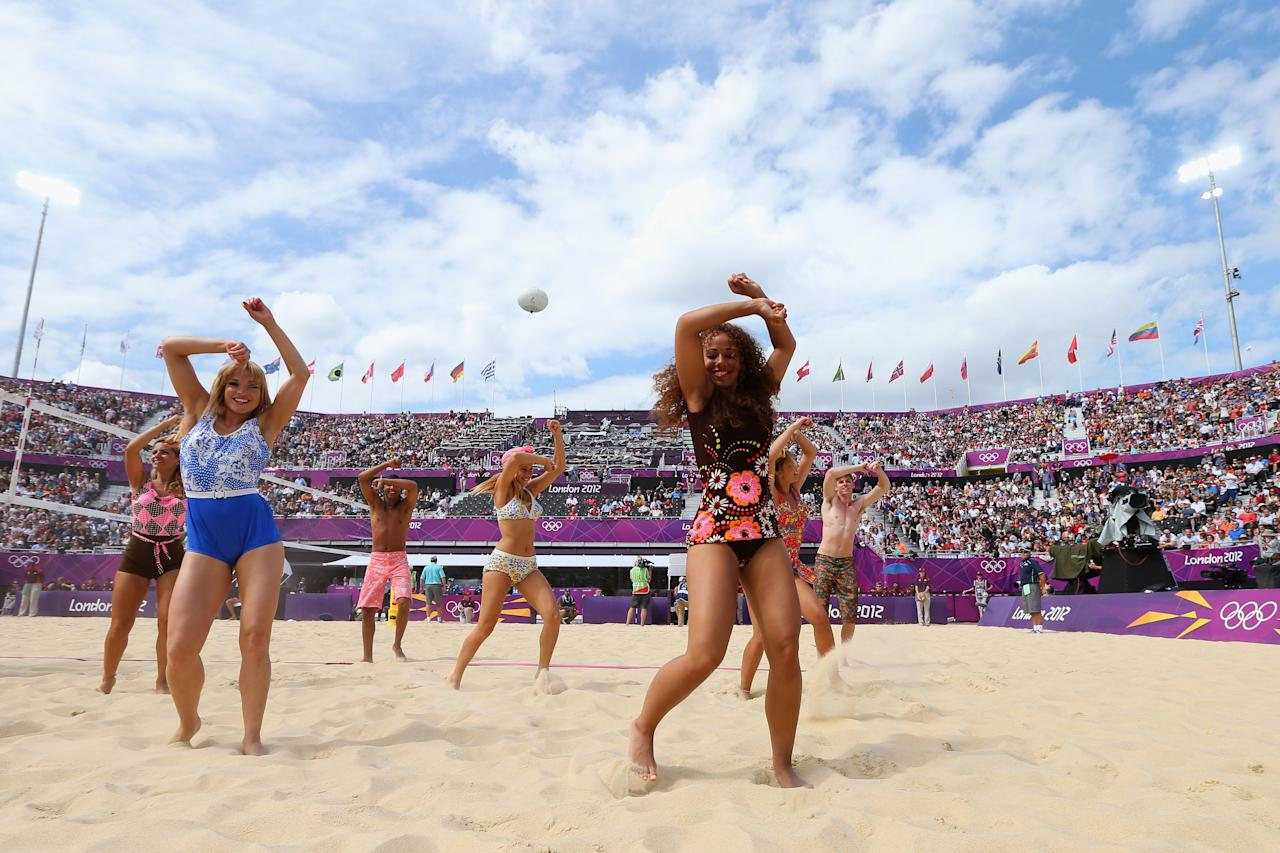 LONDON, ENGLAND - JULY 28: Cheerleaders perform during Women's Beach Volleyball on Day 1 of the London 2012 Olympic Games at Horse Guards Parade on July 28, 2012 in London, England.  (Photo by Ryan Pierse/Getty Images)