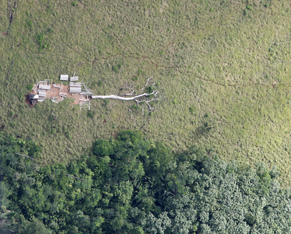An aerial view of a deforested Amazonian jungle is seen close to Maraba, in Brazil's central state of Para in this May 3, 2009 file photo.  Soon thousands of cows will be chewing pasture on the freshly cleared land in Brazil's Amazon state of Para, just a tiny part of Brazil's 200-million-strong commercial cattle herd, the world's biggest, that makes it a beef superpower.  More than 70 million are in the Amazon area, three for every person. This is where the industry has grown fastest in recent years, a trend activists say is due to cheap land, widespread illegal clearing and weak government enforcement.  Picture taken May 3, 2009.  To match feature AMAZON-CATTLE/ REUTERS/Paulo Whitaker  (BRAZIL ENVIRONMENT SOCIETY)