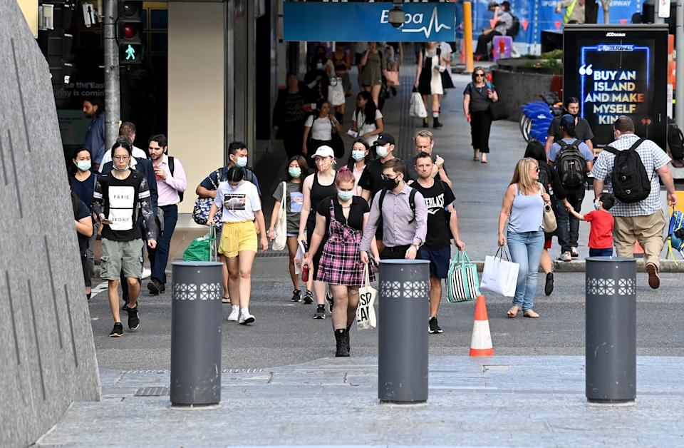 BRISBANE, AUSTRALIA - MARCH 29: People are seen wearing face masks on the Queen Street Mall in the Brisbane CBD after Queensland Premier Annastacia Palazczuk announced a three-day lockdown for the Greater Brisbane area, effective as of 5 pm on Monday. The lockdown measures for Ipswich, Logan, Redlands, Moreton and Brisbane council areas come as four new community COVID-19 cases were confirmed overnight, on March 29, 2021 in Brisbane, Australia. (Photo by Bradley Kanaris/Getty Images)