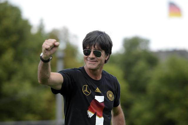 Germany's coach Joachim Loew celebrate their FIFA World Cup title at Berlin's landmark Brandenburg Gate on July 13, 2014 (AFP Photo/Clemens Bilan)