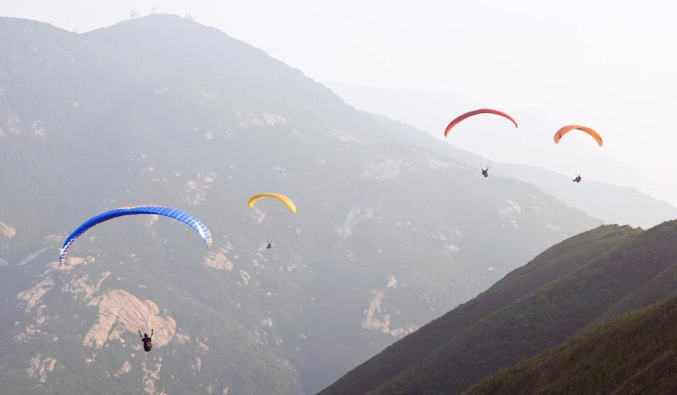 Paragliding's profile has risen in recent years, and it may be time to strengthen oversight of the sport, according to one local enthusiast. Photo: Shutterstock