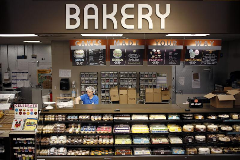 An employee works behind the bakery counter at a Kroger Co. supermarket in Louisville, Kentucky, U.S., on Tuesday, March 5, 2019. | Luke Sharrett—Bloomberg/Getty Images