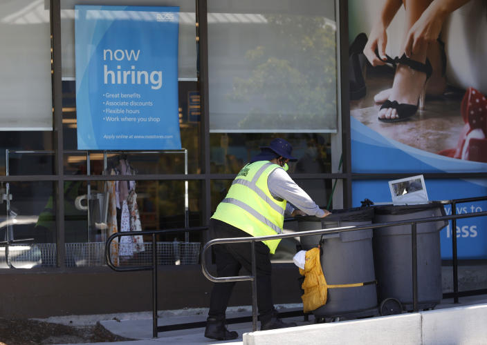 SAUSALITO, CALIFORNIA - JUNE 03: A worker pushes a cart by a Now Hiring sign outside of a Ross store on June 03, 2021 in Sausalito, California. According to a U.S. Labor Department report, jobless claims fell for a fifth straight week to 385,000. (Photo by Justin Sullivan/Getty Images)