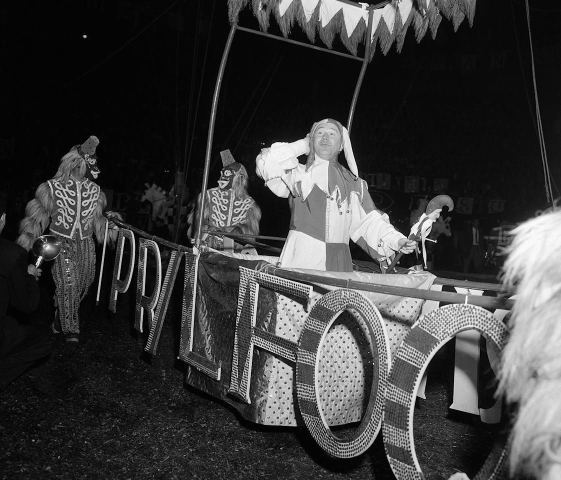 <p>Television comedian Red Buttons plays the part of April fool during parade of celebrities March 31 1934 during opening performance of Ringling Bros. and Barnum and Bailey Circus at Madison Square Garden in New York City. (AP Photo/Matty Zimmerman) </p>