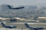 A US Air Force aircraft takes off from the airport in Kabul as the evacuation effort winds down (AFP/Aamir QURESHI)