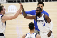 Dallas Mavericks guard Luka Doncic, left, and forward Tim Hardaway Jr., right, celebrate during a timeout in the second half in Game 5 of an NBA basketball first-round playoff series against the Los Angeles Clippers Wednesday, June 2, 2021, in Los Angeles. (AP Photo/Mark J. Terrill)