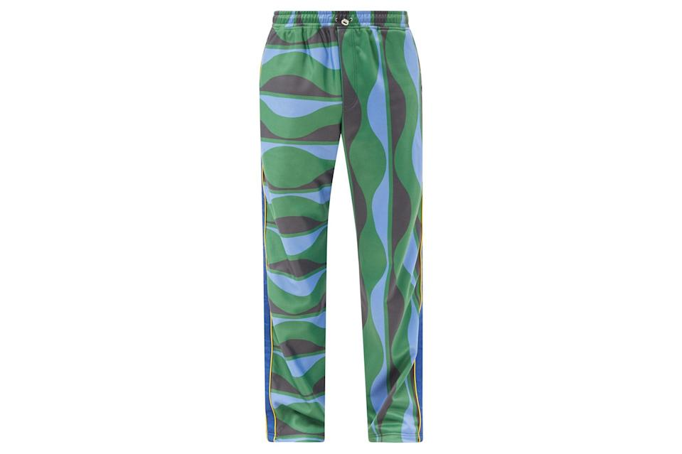 """<p>Emerge from hibernation wearing pants as lively as the blooming flora around you.</p> <p><em>Ahluwalia joy wave-print jersey track pants</em></p> $525, Matches Fashion. <a href=""""https://www.matchesfashion.com/us/products/Ahluwalia-Joy-wave-print-jersey-track-pants-1407978"""" rel=""""nofollow noopener"""" target=""""_blank"""" data-ylk=""""slk:Get it now!"""" class=""""link rapid-noclick-resp"""">Get it now!</a>"""