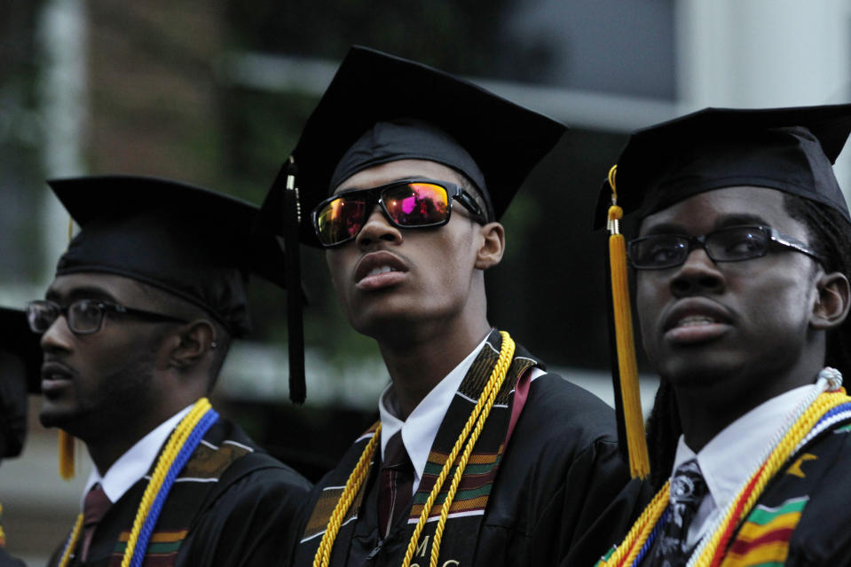A member of the Morehouse College graduating class of 2013 wears sunglasses at the ceremony attended by U.S. President Barack Obama in Atlanta, Georgia, May 19, 2013.    REUTERS/Jason Reed    (UNITED STATES - Tags: POLITICS EDUCATION)