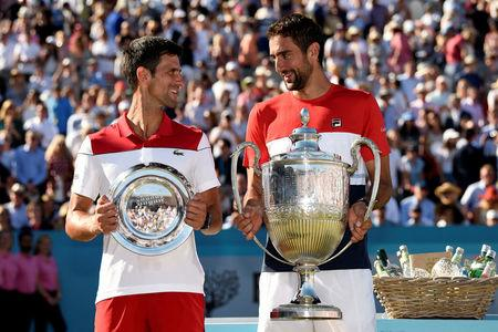 Tennis - ATP 500 - Fever-Tree Championships - The Queen's Club, London, Britain - June 24, 2018   Croatia's Marin Cilic (R) poses with the trophy after winning the final against Serbia's Novak Djokovic (L)   Action Images via Reuters/Tony O'Brien