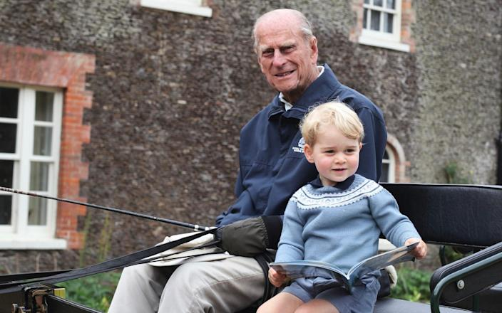 Prince Philip, the Duke of Edinburgh is seen with Prince George in this undated handout photograph made available Monday 12th April, 2021. - Duchess of Cambridge/Royal Family