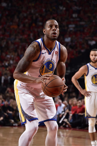 HOUSTON, TX - MAY 16: Andre Iguodala #9 of the Golden State Warriors shoots a free throw against the Houston Rockets in Game Two of the Western Conference Finals of the 2018 NBA Playoffs on May 16, 2018 at the Toyota Center in Houston, Texas. (Photo by Bill Baptist/NBAE via Getty Images)