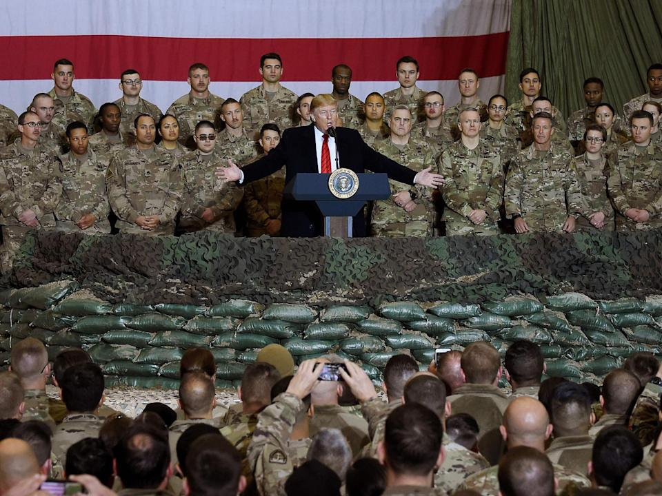 Trump speaks to the troops during a surprise Thanksgiving day visit at Bagram Air Field in Afghanistan: AFP via Getty