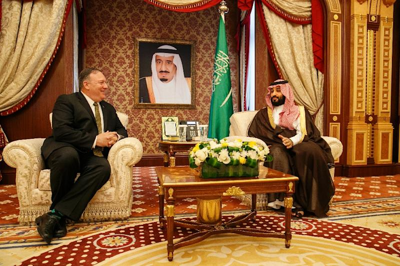 Seated under a portrait of the Saudi monarch, US Secretary of State Mike Pompeo meets with Saudi Arabia's Crown Prince Mohammed bin Salman in Jeddah (AFP Photo/Jacquelyn Martin)