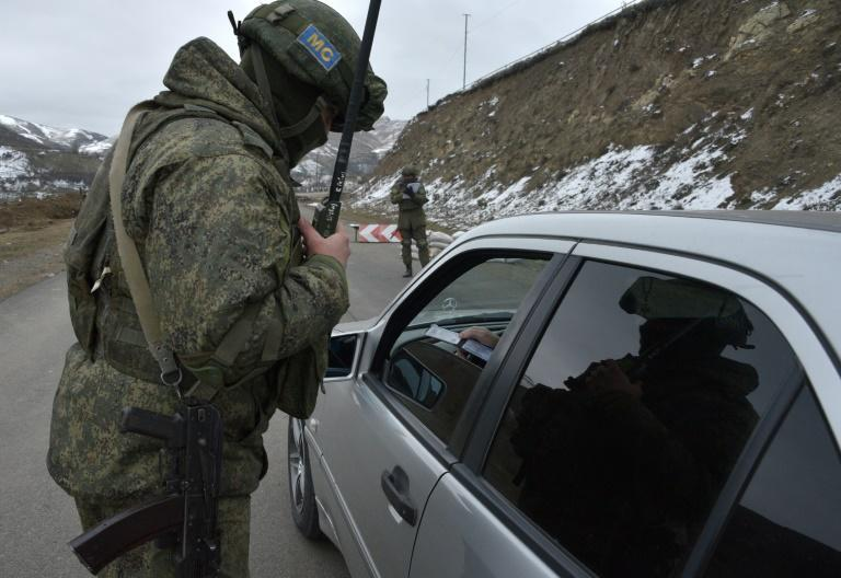 A Russian soldier of the peacekeeping force at a checkpoint